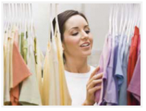 A girl choosing clothes from her wardrobe